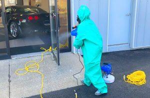 man disinfecting garage