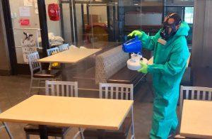 man disinfecting restaurant